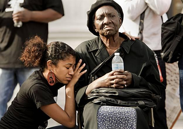 Wanda Johnson, right, mother of Oscar Grant, and Tatiana Grant, 9,