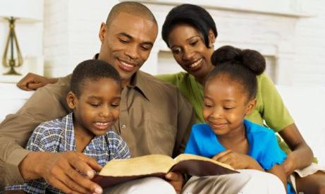 Black family reading bible 3