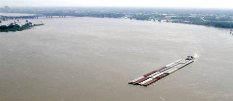 A towboat pushes barges down the flood-swollen Mississippi River south of Memphis, May 9. (Danny Johnston / AP)