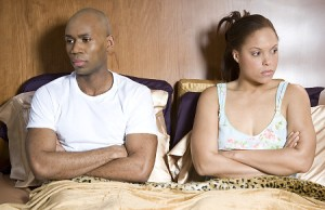 Couple sitting up in bed, both looking away   Original Filename: couple.jpg