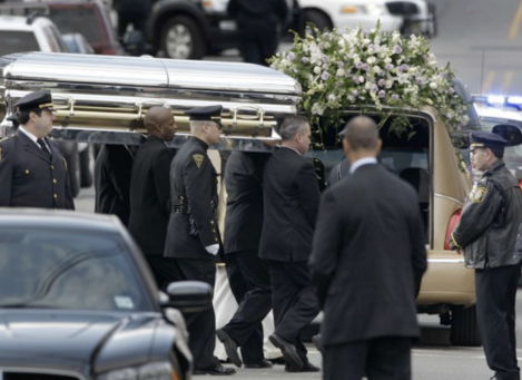 Whitney Houston's casket is carried out from New Hope Baptist Church at the conclusion of the nearly four-hour service. Mel Evans / AP