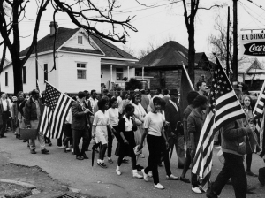 UNITED STATES - CIRCA 1965:  Participants, some carrying American flags, marching in the civil rights march from Selma to Montgomery, Alabama in 1965  (Photo by Buyenlarge/Getty Images)